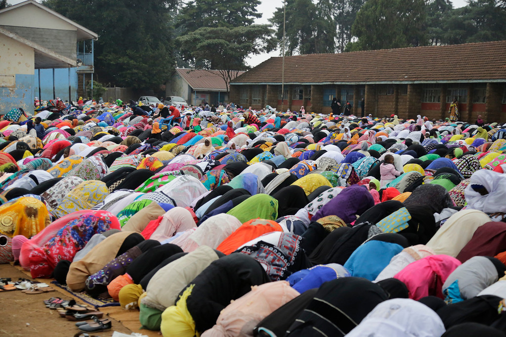 . Kenyan Muslims pray during the Eid al-Fitr prayers in Kibera Nairobi, Kenya, Friday, June 15, 2018. Muslims around the world celebrate the end of the holy month of Ramadan. (AP Photo/Khalil Senosi)