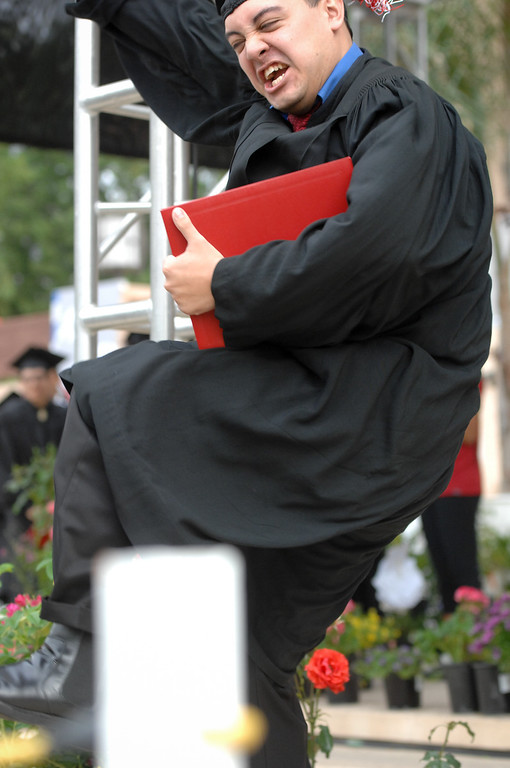 . A graduate kick up his heals at the CSUN commencement ceremony, Tuesday, May 21, 2013. (Michael Owen Baker/L.A. Daily News)