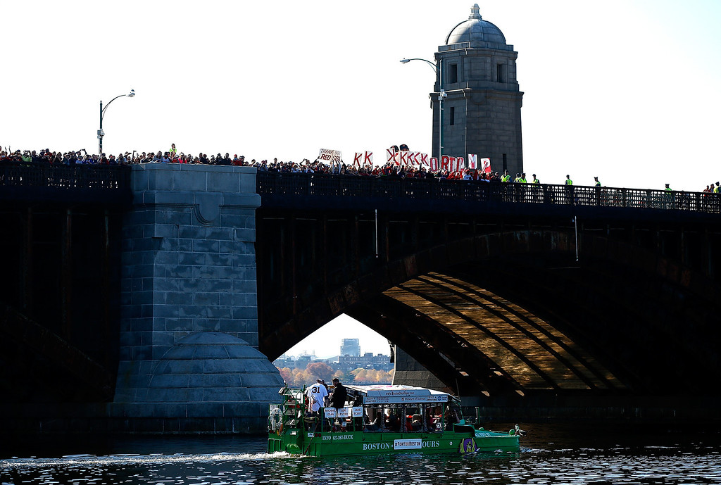 . BOSTON, MA - NOVEMBER 02:  Boston Red Sox fans cheer from the Longfellow Bridge as a duck boat carrying Jon Lester #31 of the Boston Red Sox passes by during the World Series victory parade on November 2, 2013 in Boston, Massachusetts.  (Photo by Jared Wickerham/Getty Images)