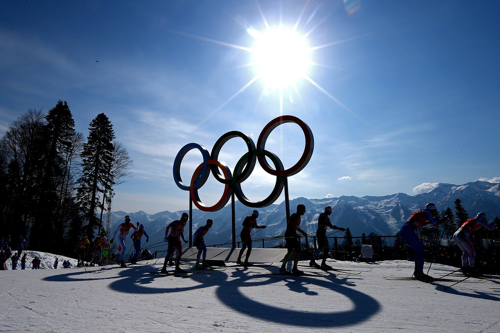 . Cross country skiers competes past the Olympic Rings on the first leg of the Cross Country Men\'s 4 x 10 km Relay during day nine of the Sochi 2014 Winter Olympics at Laura Cross-country Ski & Biathlon Center on February 16, 2014 in Sochi, Russia.  (Photo by Clive Mason/Getty Images)