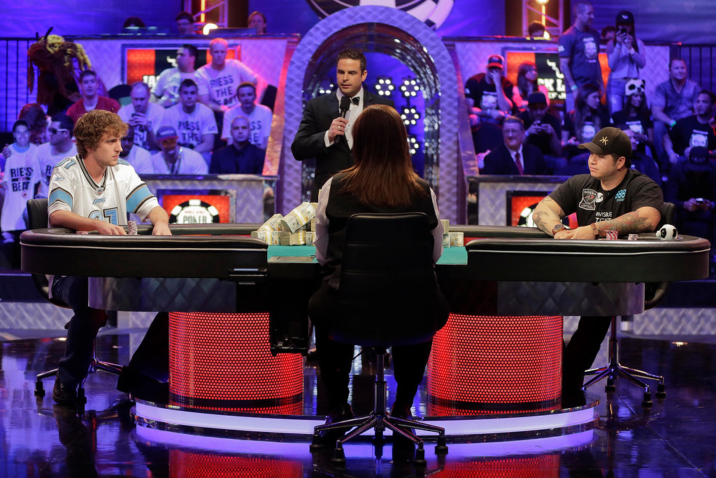. Ryan Riess, left, and Jay Farber begin play as the two remaining players at the World Series of Poker final table, Tuesday, Nov. 5, 2013, in Las Vegas. (AP Photo/Julie Jacobson)