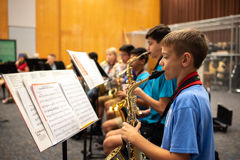 """Islander Band Camp students practice scores from """"Star Wars: The Last Jedi"""" in the Center for Arts."""