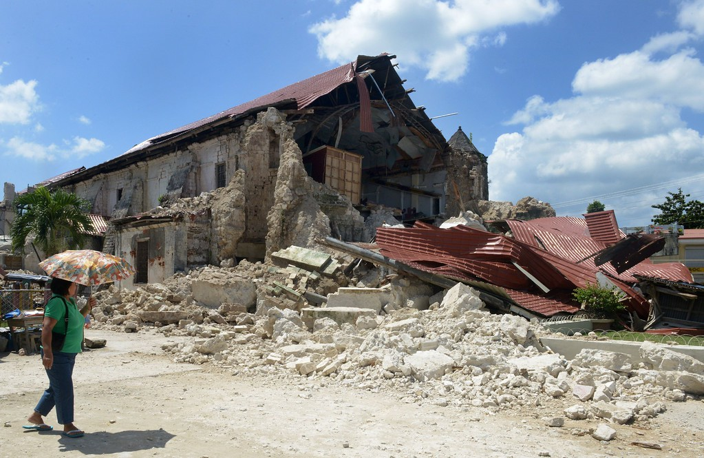 . A Philippine pedestrian passes the ruins of the historic Loboc Church in Loboc town on the central Philippine island of Bohol on October 18, 2013.  AFP PHOTO/ Jay  DIRECTO/AFP/Getty Images
