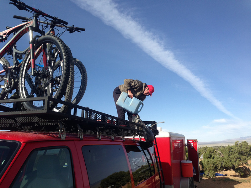 . Western Spirit Cycling Adventures owner Mark Sevenoff fills a portable shower. Handout Photo