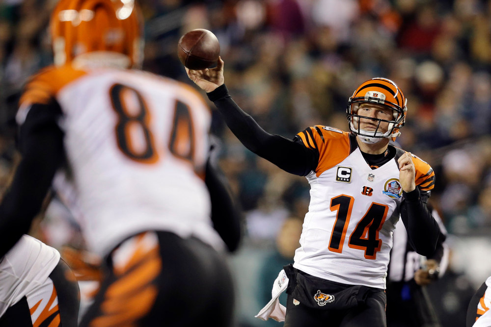 Description of . Cincinnati Bengals' Andy Dalton passes in the first half of an NFL football game against the Philadelphia Eagles, Thursday, Dec. 13, 2012, in Philadelphia. (AP Photo/Mel Evans)
