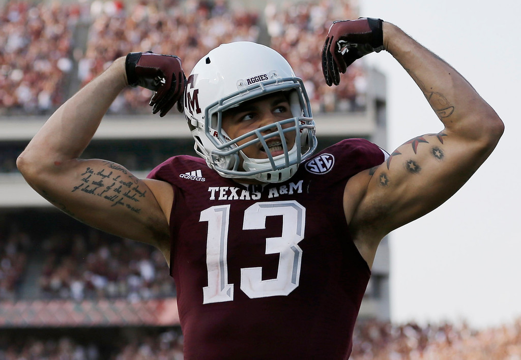 . Texas A&M wide receiver Mike Evans (13) celebrates his 95-yard touchdown against Alabama during the fourth quarter of an NCAA college football game Saturday, Sept. 14, 2013, in College Station, Texas. (AP Photo/David J. Phillip)