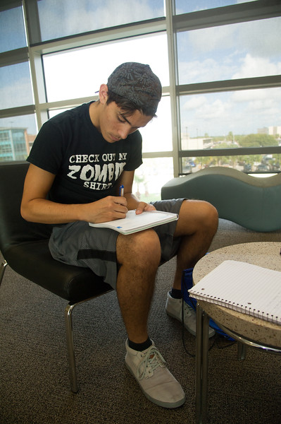 Student Brandon Besse, plans out his weekly schedule in the O'Connor building.