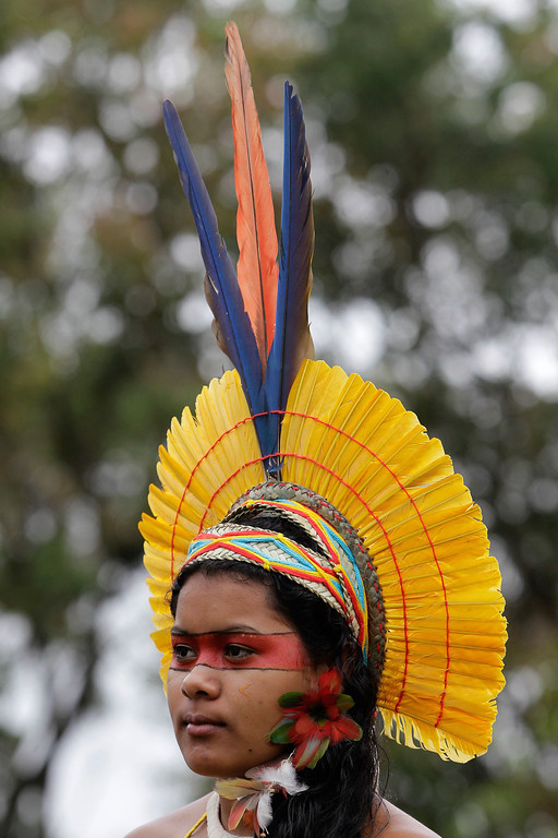 . A Pataxo Indian young takes part in the first day of  the National Indigenous Mobilization protest in Brasilia, Brazil, Tuesday, Oct. 1, 2013. The protest is against a proposed constitutional amendment known as PEC 215, which amends the rules for demarcation of indigenous lands. (AP Photo/Eraldo Peres)