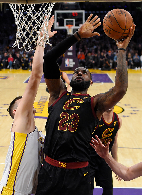 . Cleveland Cavaliers forward LeBron James, right, shoots as Los Angeles Lakers center Ivica Zubac, of Croatia, defends during the second half of an NBA basketball game, Sunday, March 11, 2018, in Los Angeles. The Lakers won 127-113. (AP Photo/Mark J. Terrill)