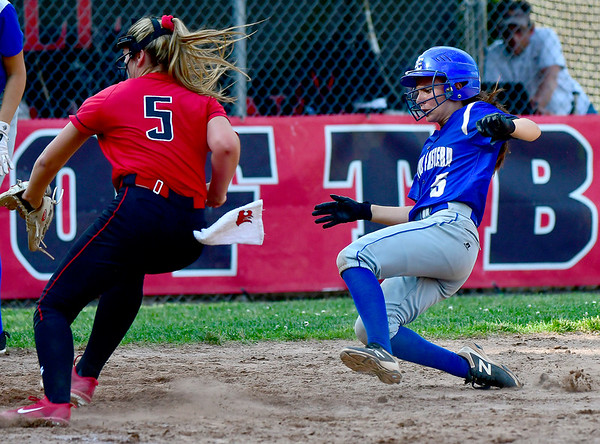 5/31/2019 Mike Orazzi | Staff Masuk's Samantha Schiebe (5) covers the plate as Bristol Eastern's Taylor Keegan (5) in the Class L Quarterfinals softball game on Friday.