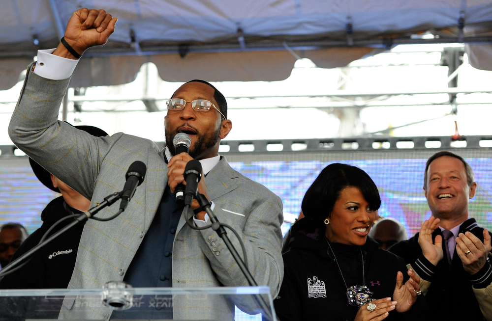 . Baltimore Ravens linebacker Ray Lewis, left, addresses fans as Baltimore Mayor Stephanie Rawlings-Blake, center, and Maryland Gov. Martin O\'Malley cheer during a send-off rally Monday, Jan. 28, 2013 in Baltimore. The team was leaving for New Orleans to play against the San Francisco 49ers in the Super Bowl. (AP Photo/Steve Ruark)