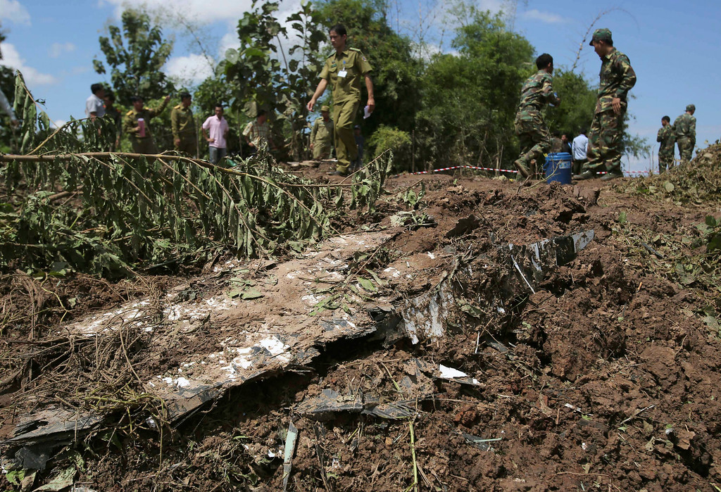 . Lao soldiers work at the scene where a Lao Airlines turboprop plane hit before skidding into the Mekong River, in Pakse, Laos on Thursday, Oct. 17, 2013.   (AP Photo/Sakchai Lalit)