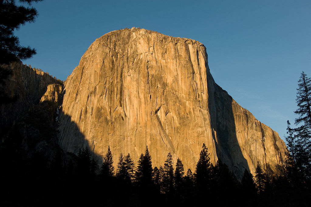 . El Capitan is a favorite for experienced rock climbers. Rising more than 3,000 feet above the Valley floor, it is the largest monolith of granite in the world. El Capitan is opposite Bridalveil Fall and is best seen from the roads in western Yosemite Valley, including Tunnel View, Bridalveil Fall area, and El Capitan Meadow.(Photo by Walt Mancini)