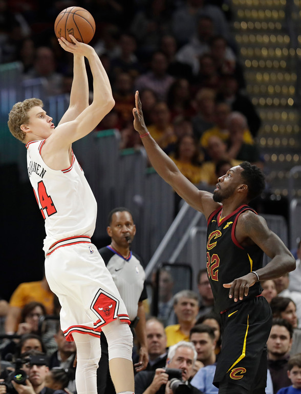 . Chicago Bulls\' Lauri Markkanen, from Finland, shoots over Cleveland Cavaliers\' Jeff Green during the first half of an NBA basketball game Thursday, Dec. 21, 2017, in Cleveland. (AP Photo/Tony Dejak)