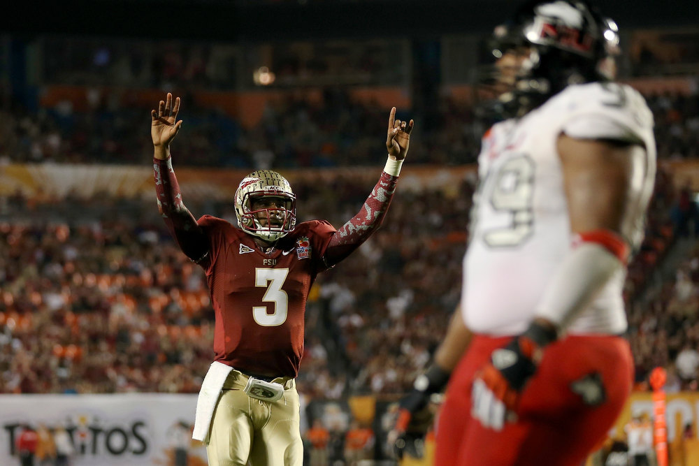 Description of . EJ Manuel #3 of the Florida State Seminoles celebrates after he threw a 6-yard touchdown pass to Rashad Greene #80 in the second quarter against the Northern Illinois Huskies during the Discover Orange Bowl at Sun Life Stadium on January 1, 2013 in Miami Gardens, Florida.  (Photo by Streeter Lecka/Getty Images)