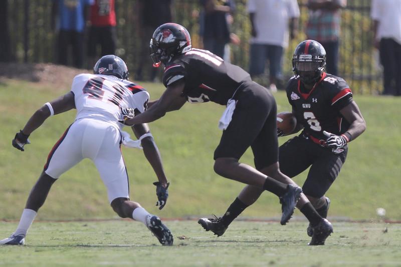 Kenny Little (6) runs the ball