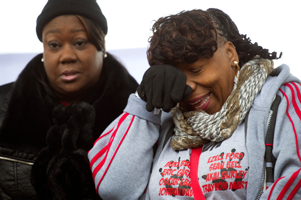 . Sabrina Fulton, mother of Trayvon Martin, left, and Gwen Carr, mother of Eric Garner, stand onstage after speaking during a civil rights advocates rally to honor the Rev. Martin Luther King, Jr. in Washington, Saturday, Jan. 14, 2017.  (AP Photo/Cliff Owen)