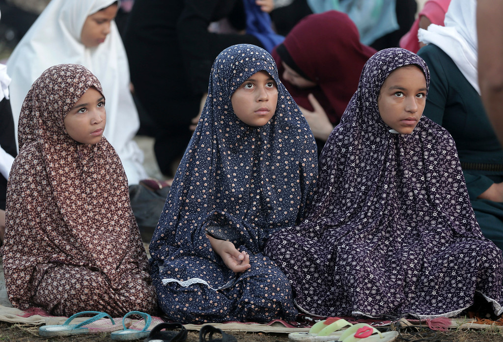 . Palestinian Muslims pray to mark the first day of Eid al-Adha, or Feast of the Sacrifice, in Gaza City, Monday, Sept. 12, 2016. Muslims around the world celebrate Eid al-Adha by sacrificing animals to commemorate the prophet Ibrahim\'s faith in being willing to sacrifice his son. (AP Photo/Khalil Hamra)