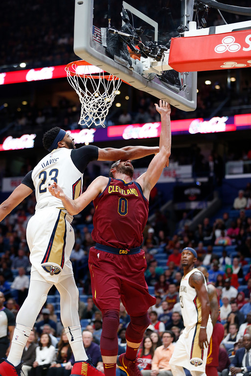 . New Orleans Pelicans forward Anthony Davis (23) blocks a shot by Cleveland Cavaliers forward Kevin Love (0) in the first half of an NBA basketball game in New Orleans, Saturday, Oct. 28, 2017. (AP Photo/Gerald Herbert)