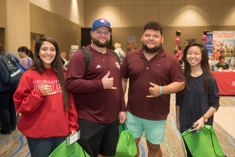 Kayla Weeks (left) John Meriwether, Vincent Verduzco and Aimee Chin during the Community Fair in the UC Anchor Ballroom.