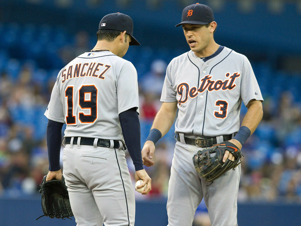 . Detroit Tigers\' Ian Kinsler talks to starting pitcher Anibal Sanchez on the mound after the Toronto Blue Jays scored on a squeeze bunt during the second inning of a baseball game, Friday, Aug. 8, 2014 in Toronto. (AP Photo/The Canadian Press, Fred Thornhill)