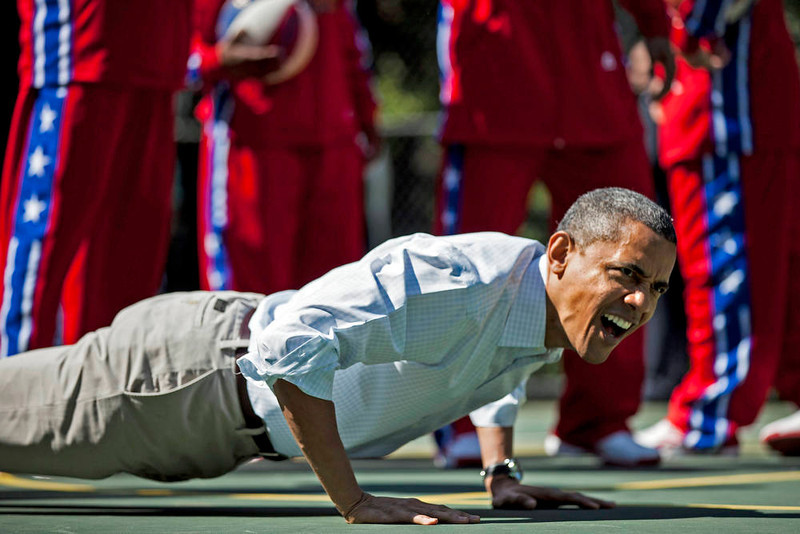 . US President Barack Obama does pushups during backetball shooting drills during the annual Easter Egg Roll on the South Lawn of the White House April 9, 2012 in Washington, DC.  The First Family participated in the yearly event where the South Lawn is opened up to guests to participate in various egg rolls and other activities.  AFP PHOTO/Brendan  SMIALOWSKI/AFP/Getty Images