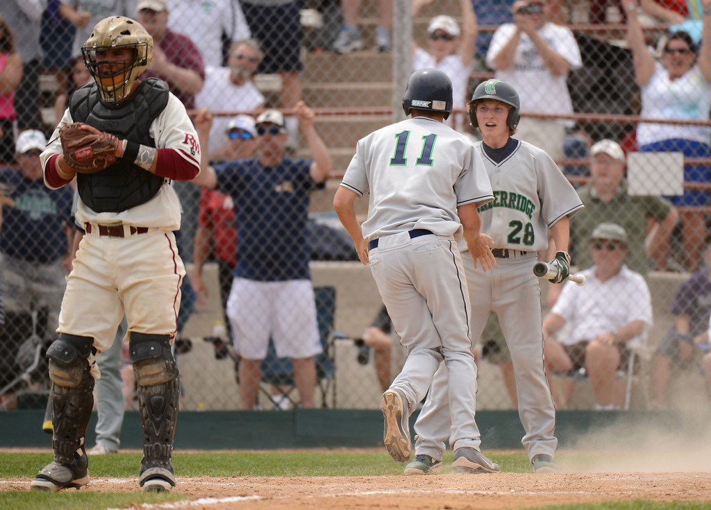 . DENVER, CO. - MAY 25: Mark Hopper (11) and Aaron Germani (28) of ThunderRidge HIgh School celebrate Hopper\'s scoring in the 7th inning of 5A baseball state championship game against Rocky Mountain High School at All City Field. Denver, Colorado. May 25, 2013. ThunderRidge won 2-1. (Photo By Hyoung Chang/The Denver Post)