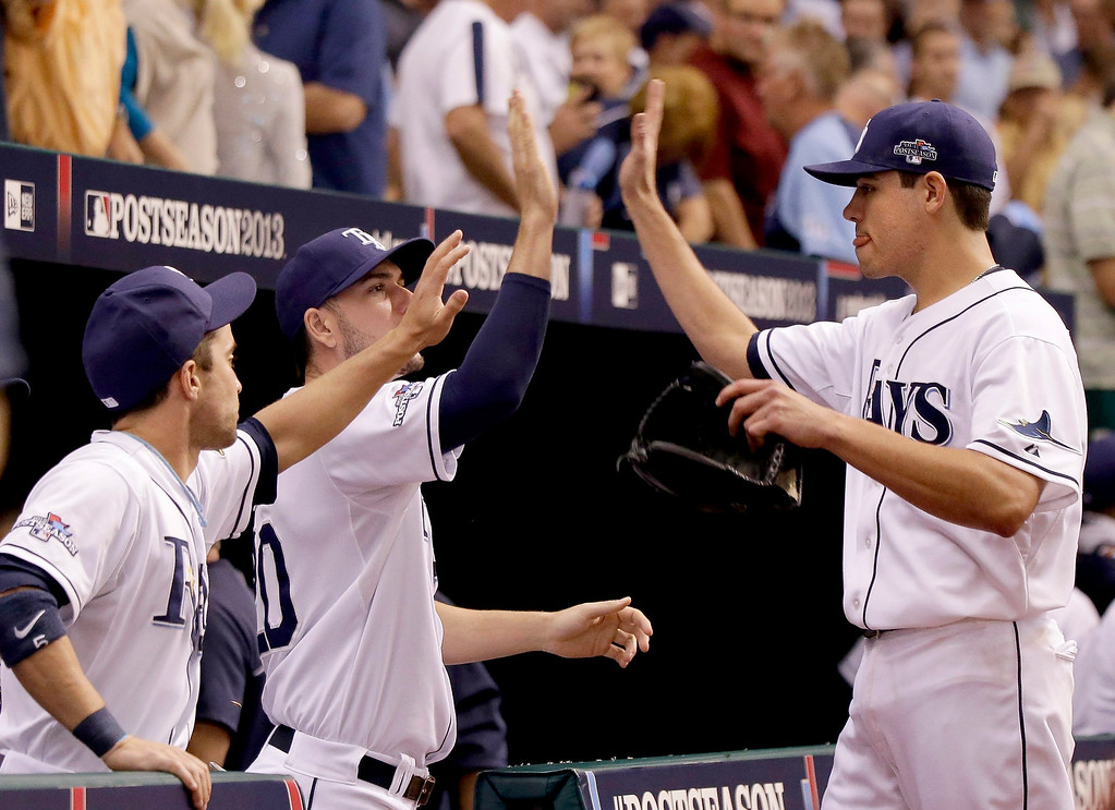 . Tampa Bay Rays starting pitcher Matt Moore (55) is congratulated as he gets out of the 4th inning in Game 4 of the American League Division Series playoffs against the Boston Red Sox at Tropicana Field in St. Petersburg, Florida, on Tuesday, October 8, 2013. (Dirk Shadd/Tampa Bay Times/MCT)