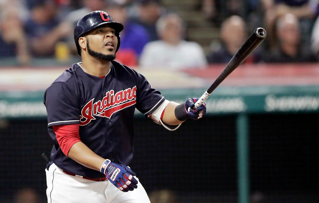 . Cleveland Indians\' Edwin Encarnacion watches his ball after hitting a one-run double off Minnesota Twins starting pitcher Kohl Stewart in the fifth inning of a baseball game, Wednesday, Aug. 29, 2018, in Cleveland. (AP Photo/Tony Dejak)