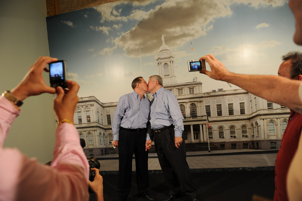 . NEW YORK, NY - JULY 24:  Same-sex couple Ray Durand (L) and his partner Dale Shields kiss while having their picture taken after their wedding ceremony at the Manhattan City Clerk\'s office on the first day New York State\'s Marriage Equality Act goes into effect July 24, 2011 in New York City. Today was the first day gay couples were allowed to legally marry in New York State after Gov. Andrew Cuomo signed the historic legislation into law.  (Photo by David Handschuh-Pool/Getty Images)