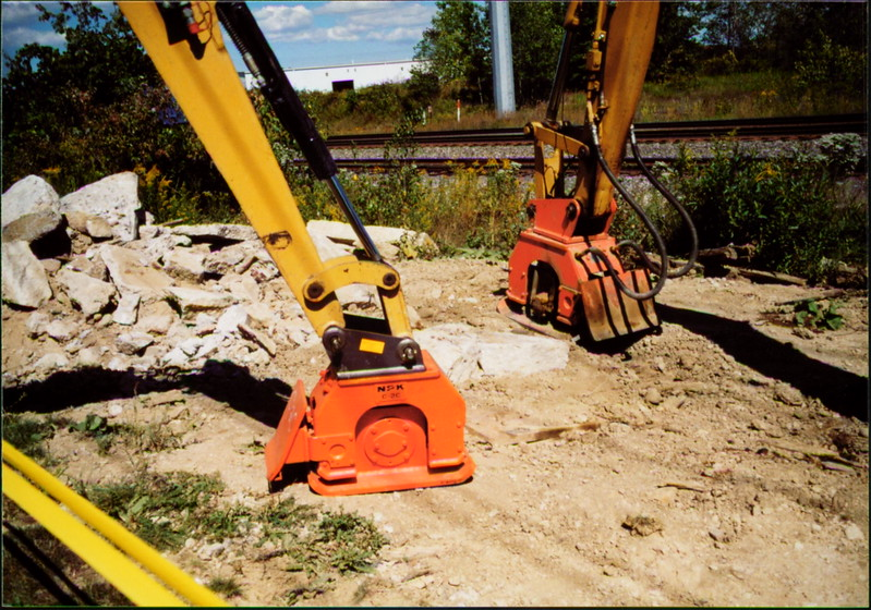 NPK C2C and C4C compactors with backfill blades on Cat mini excavators (1).JPG
