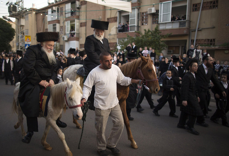 . Ultra-Orthodox Jews ride horses during the wedding of the great-grandson of the Rabbi of the Tzanz Ultra-Orthodox Hasidic community in Netanya, on January 1, 2013. MENAHEM KAHANA/AFP/Getty Images