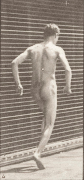 Nude man hopping on right foot