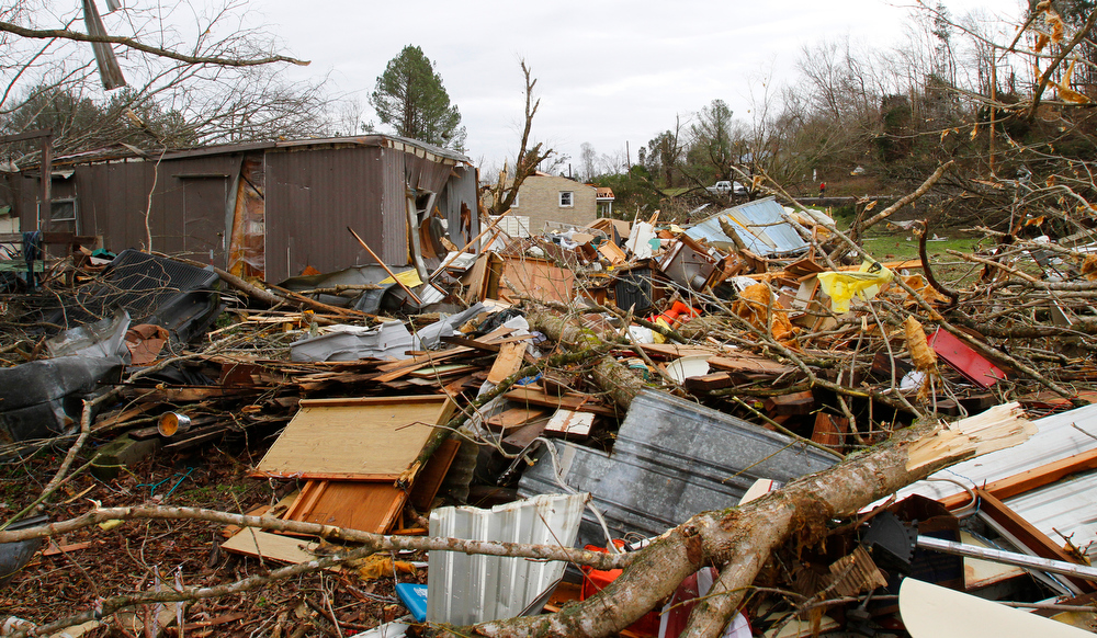 Description of . Several houses and businesses were destroyed after a storm ripped through Coble, Tenn. early Wednesday, Jan. 30, 2013. A large storm system packing high winds, hail and at least one tornado tore across a wide swath of the South and Midwest on Wednesday, killing one person, blacking out power to thousands and damaging homes. (AP Photo/Butch Dill)