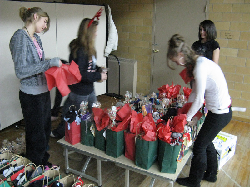 Final touches on over a hundred gift bags.