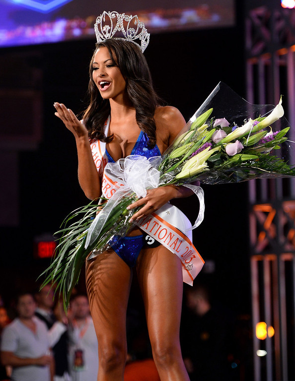 . Marissa Raisor of Newport, Kentucky blows a kiss after being crowned Miss Hooters International 2013 at the 17th annual Hooters International Swimsuit Pageant at The Joint inside the Hard Rock Hotel & Casino on June 27, 2013 in Las Vegas, Nevada.  (Photo by Ethan Miller/Getty Images)