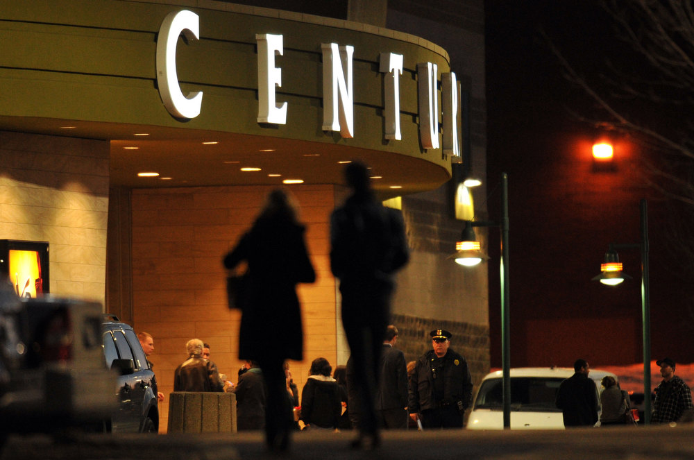 Description of . AURORA, CO - JANUARY 17: A couple heads into the Century Aurora. The movie theater where a gunman killed 12 people and wounded dozens of others reopened with a private ceremony for victims, first responders and officials. (Photo By Hyoung Chang / The Denver Post)