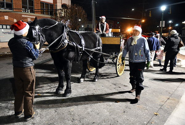 12/6/2019 Mike Orazzi | StaffrHorse drawn carriage rides during Southington's White Christmas in the Community on the town green on Friday evening.