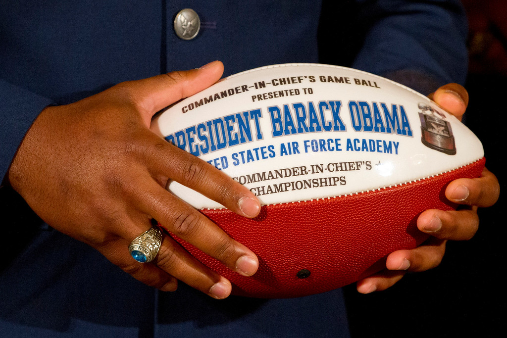 . U.S. Air Force Academy football team defensive back Christian Spears holds a football to present to President Barack Obama during an event in the East Room of the White House in Washington, Thursday, May 7, 2015, where the president honored the U.S. Air Force Academy football team with the Commander-in-Chief Trophy. (AP Photo/Jacquelyn Martin)