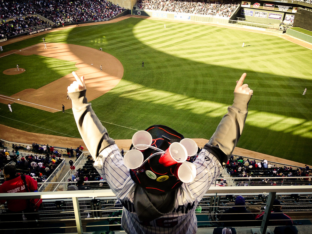 . A fan in the Target Field nosebleed section cheers as the Twins play the A\'s. (Pioneer Press: Ben Garvin)