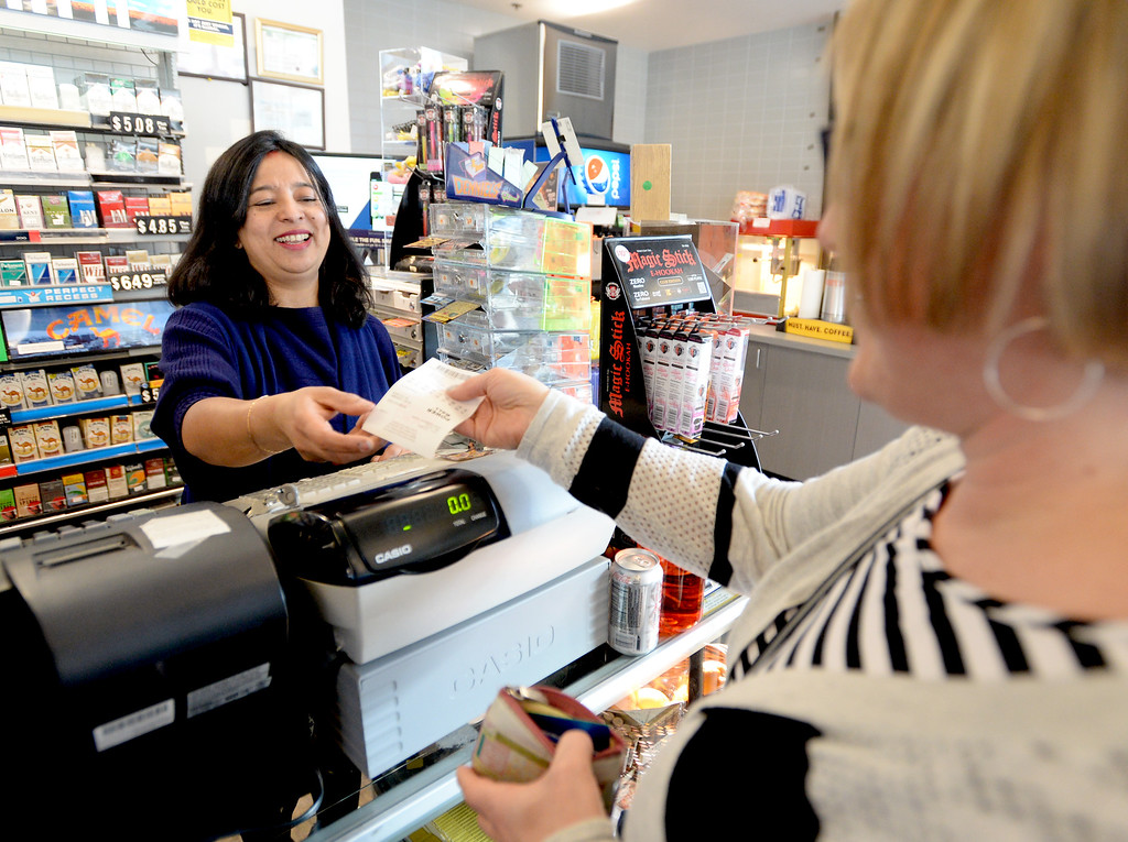 . Powerball16.JPG Venus Sakha, left, owner of The General Store with her husband, sells Amy Hogan a Powerball ticket on Tuesday, January 12, 2016.  Cliff Grassmick/Boulder Daily Camera