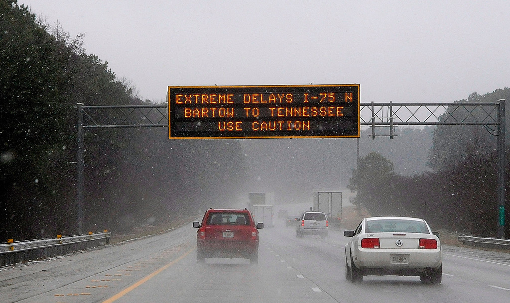 """. A Georgia transportation sign warns motorists on Interstate 75 on Tuesday, Feb. 11, 2014, in Kennesaw, Ga., about 20 miles north of metro Atlanta.  A winter snow storm is  blowing into Georgia in what the National Weather Service predicted to be \""""an event of historical proportions.\""""  (AP Photo/David Tulis)"""