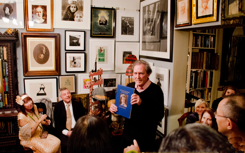 """Birthday party at Robert Flynn Johnson - Robert giving talk on his new book, """"Contemplating Character"""". Sheila Ash on left; Mehram Sheikholeslami, 2nd on left"""
