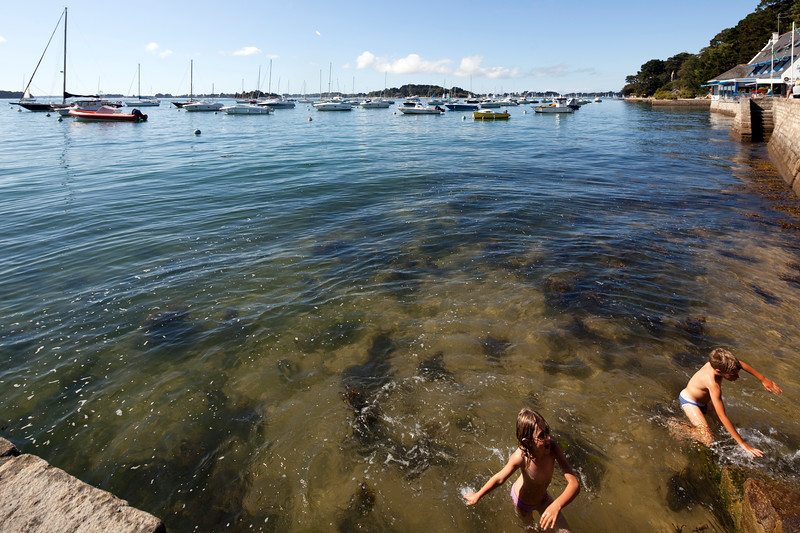 Children playing in the sea, Arradon point, departament of Morbihan, Brittany, France