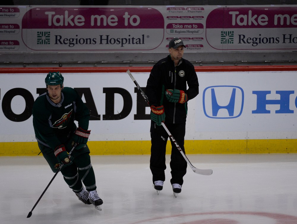 . Minnesota Wild head coach Mike Yeo looks on during the teams practice April 23, 2014 at Xcel Energy Center. (Photo by John Leyba/The Denver Post)