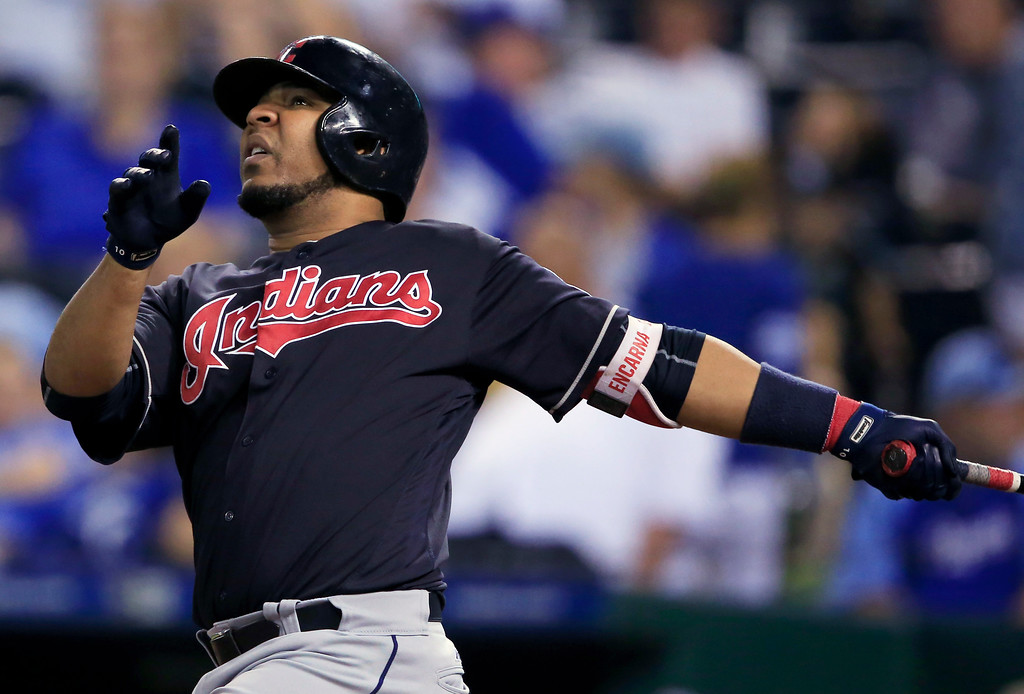 . Cleveland Indians\' Edwin Encarnacion watches a solo home run during the ninth inning of a baseball game against the Kansas City Royals at Kauffman Stadium in Kansas City, Mo., Friday, Aug. 18, 2017. The Indians defeated the Royals 10-1. (AP Photo/Orlin Wagner)