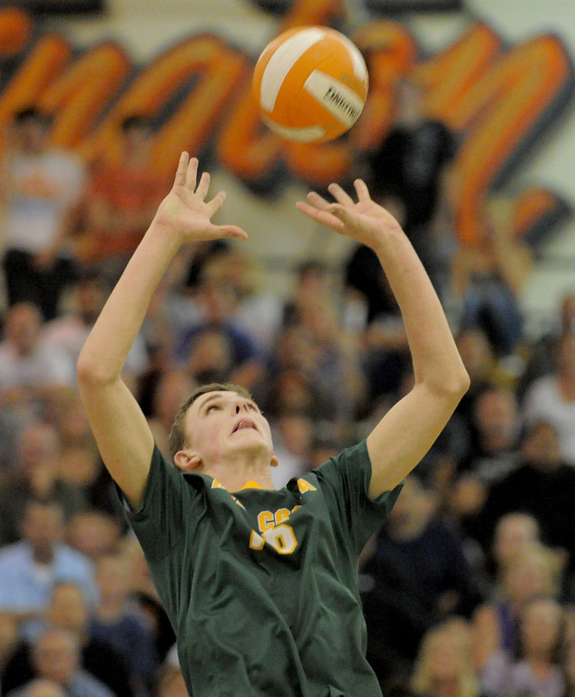 . 05-15-2013-( Daily Breeze Staff Photo by Sean Hiller) Huntington Beach swept Mira Costa in Wednesday\'s  boys volleyball CIF Southern Section Division I semifinal at Huntington Beach High School. Grant Chalmers sets the ball.
