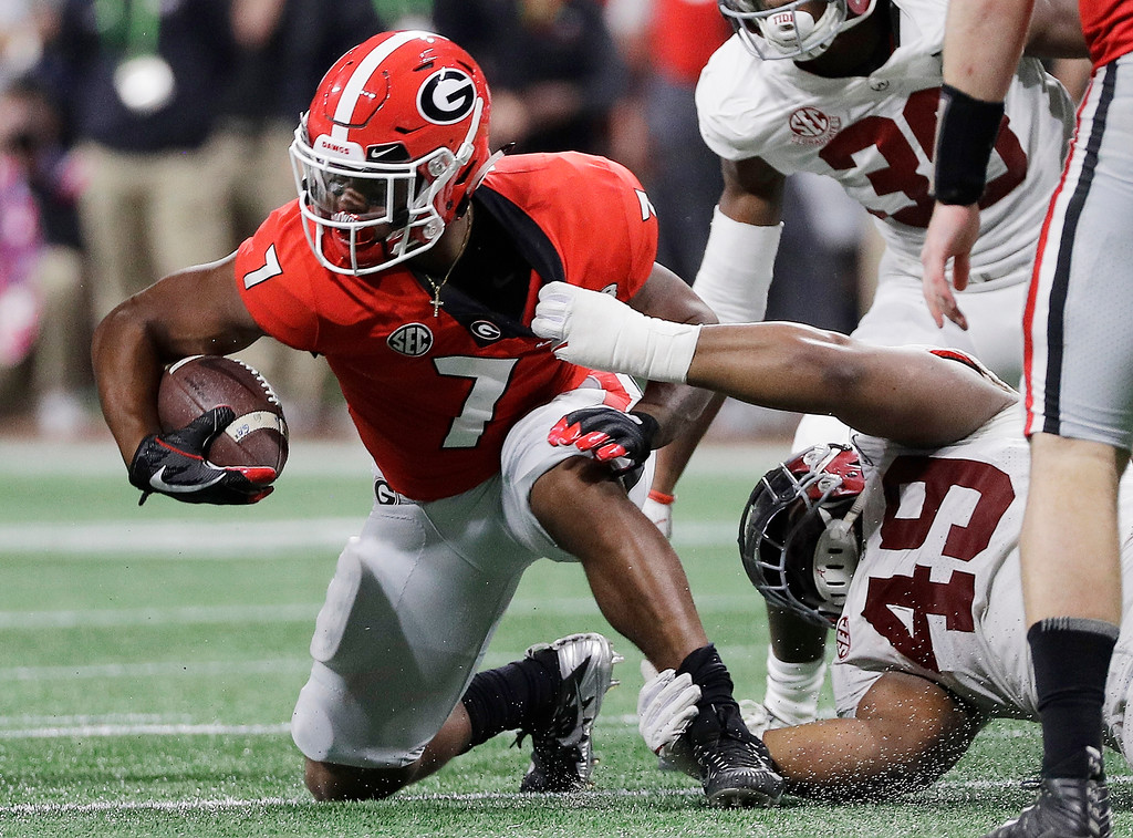 . Alabama\'s Isaiah Buggs tackles Georgia\'s D\'Andre Swift\\ for a loss during the second half of the NCAA college football playoff championship game Monday, Jan. 8, 2018, in Atlanta. (AP Photo/David J. Phillip)