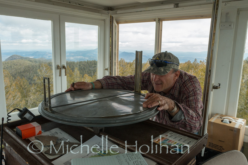 MANGAS MOUNTAIN, NEW MEXICO: APRIL 27, 2015: Taking a bearing at the Mangas Fire Lookout.