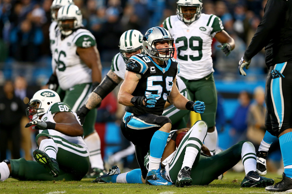 . Luke Kuechly #59 of the Carolina Panthers reacts after making a sack on Geno Smith #7 of the New York Jets during their game at Bank of America Stadium on December 15, 2013 in Charlotte, North Carolina.  (Photo by Streeter Lecka/Getty Images)